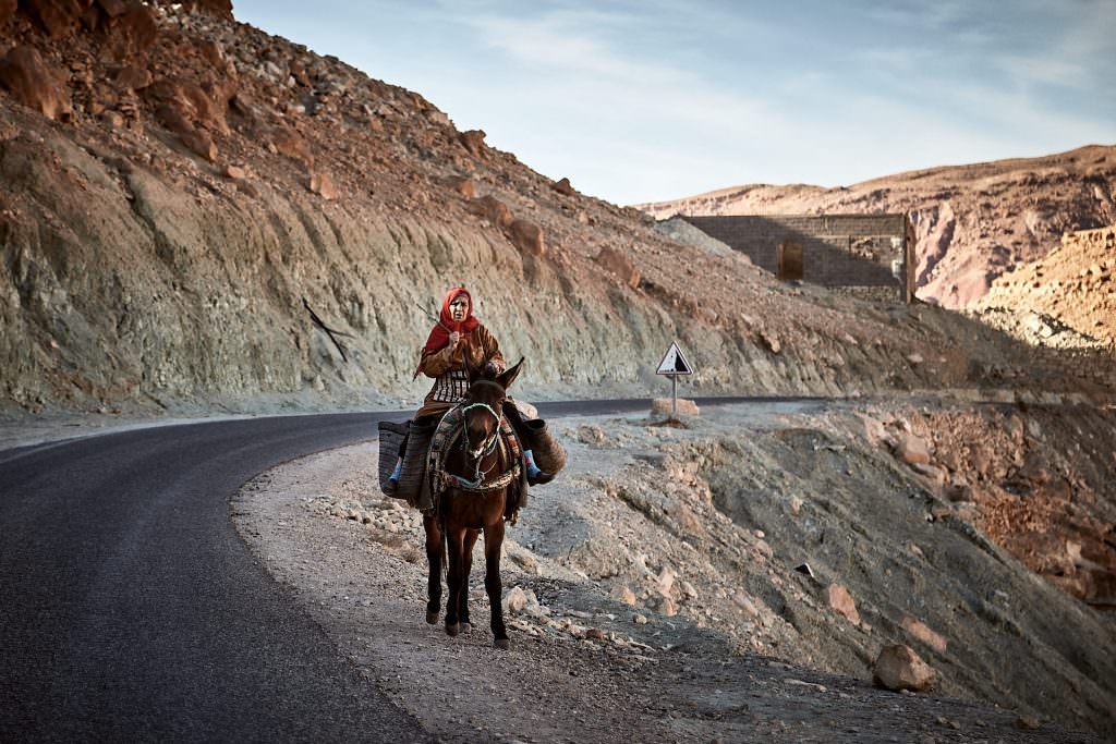Old woman riding a donkey - Morocco